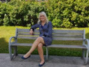 Leigh Ann sitting in park.jpg