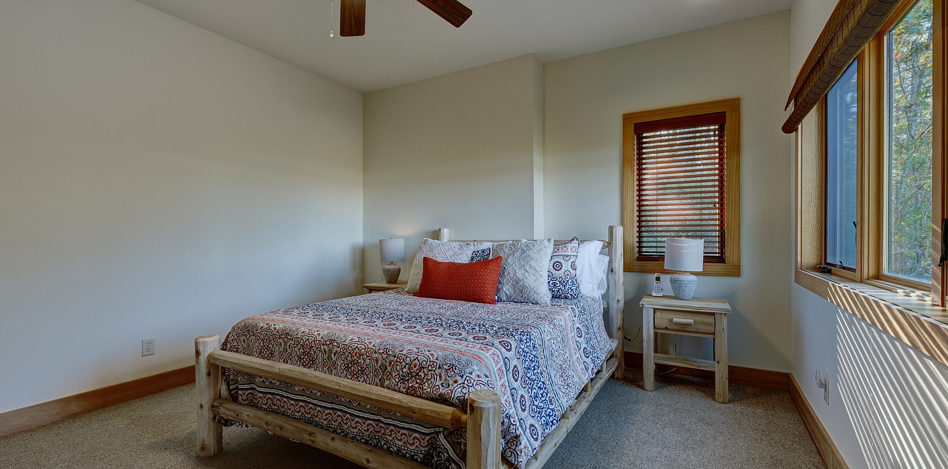 """The Queen bedroom features rustic white cedar log furniture and a 12"""" memory foam mattress and fine linens."""