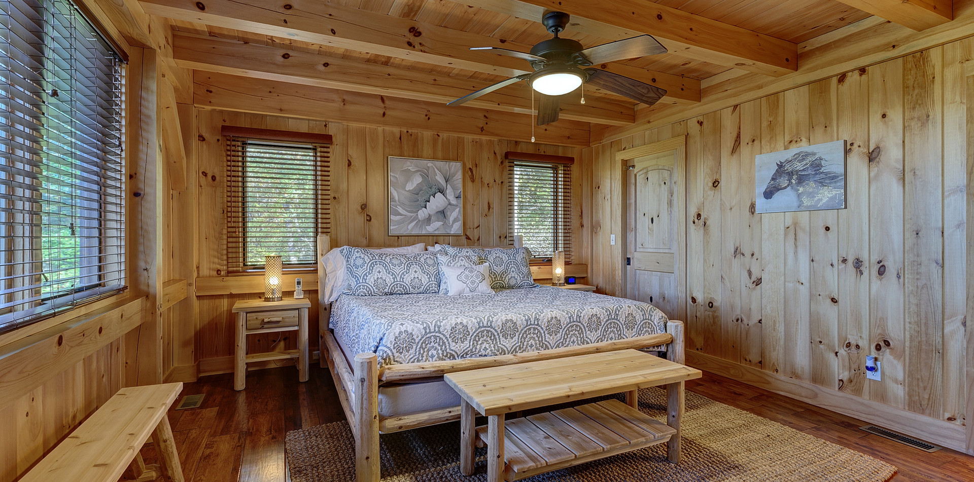 """The master bedroom features rustic white cedar log furniture. Relax in the King-size bed which has 12"""" memory foam mattress and fine linens."""