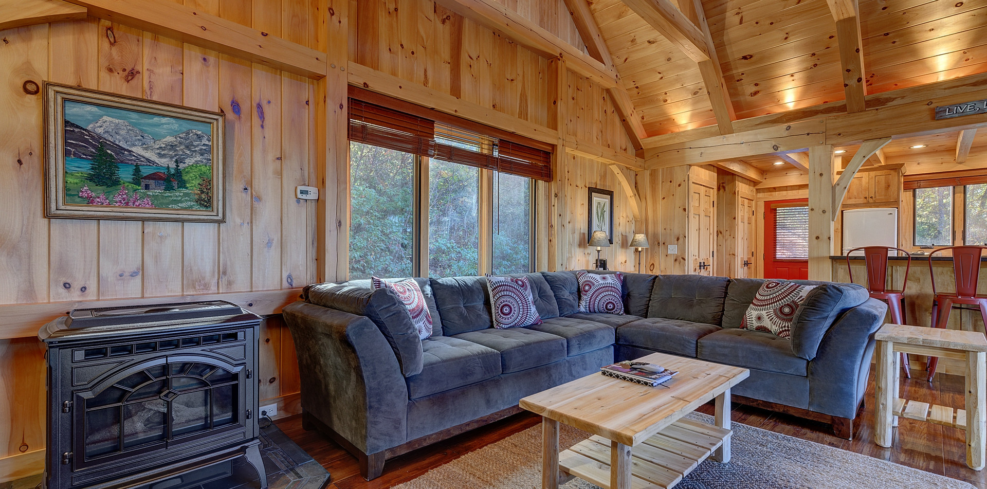 The cottage features a spacious open-concept living area with pellet stove to keep you warm in the winter months.