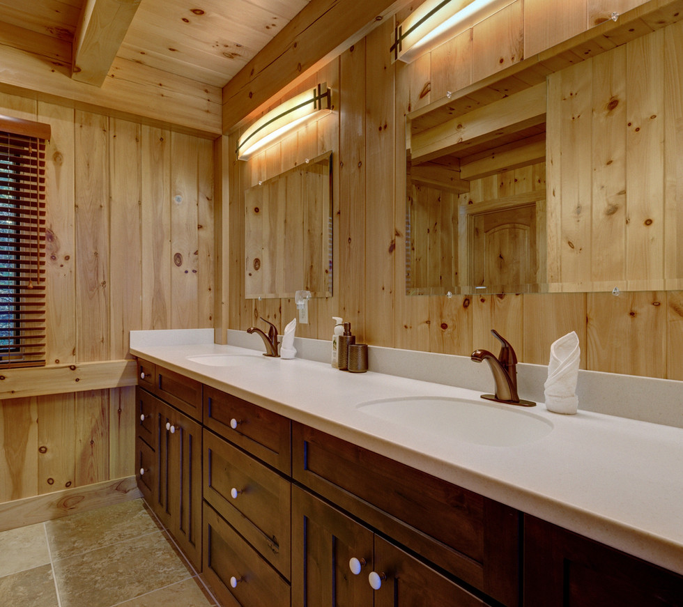 The master bathroom features a double vanity and a large walk-in shower.
