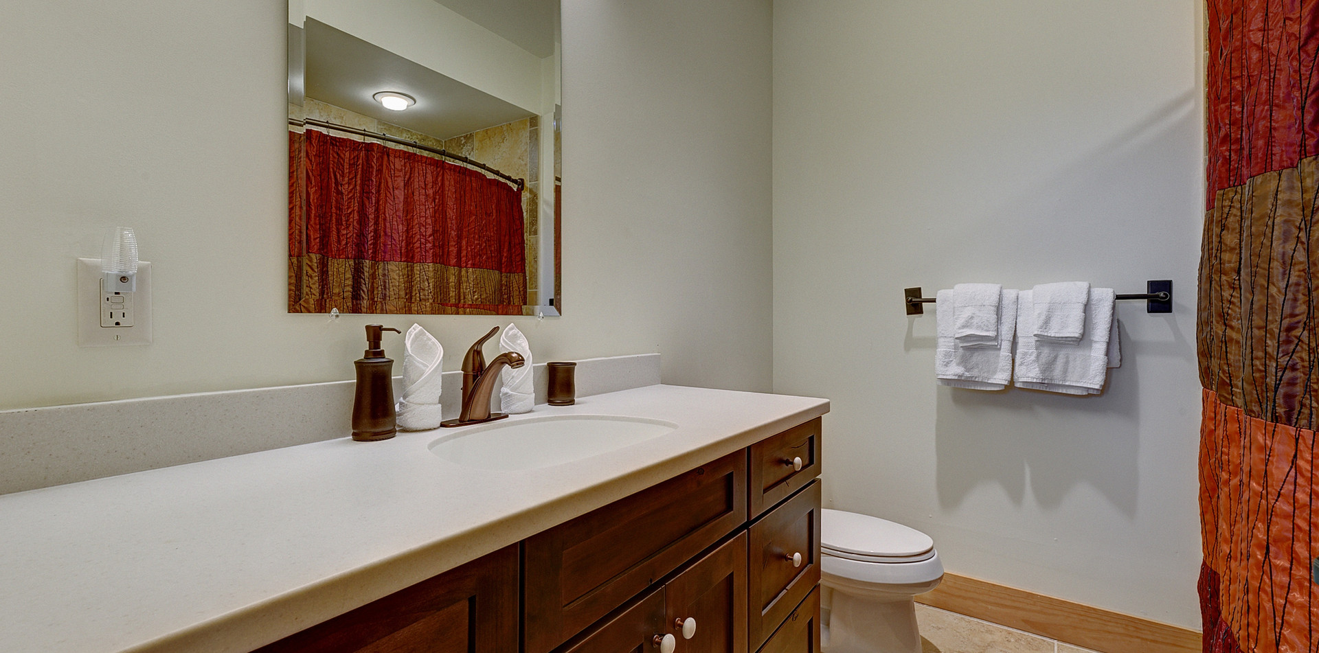 The second full bathroom is on the lower level.