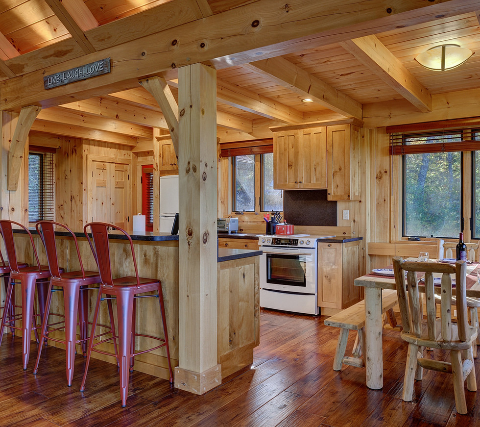 The dining area has a farmhouse table that seats eight. There are also four bar stools at the island.