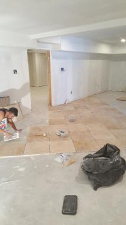 Travertine floors being installed