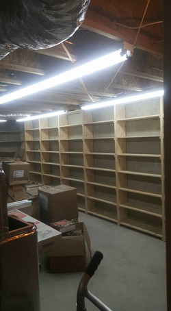 Shelving being built in storage room for books