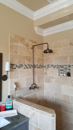 Travertine and tile shower