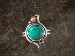 Turquoise Cabochon in silver with copper detail