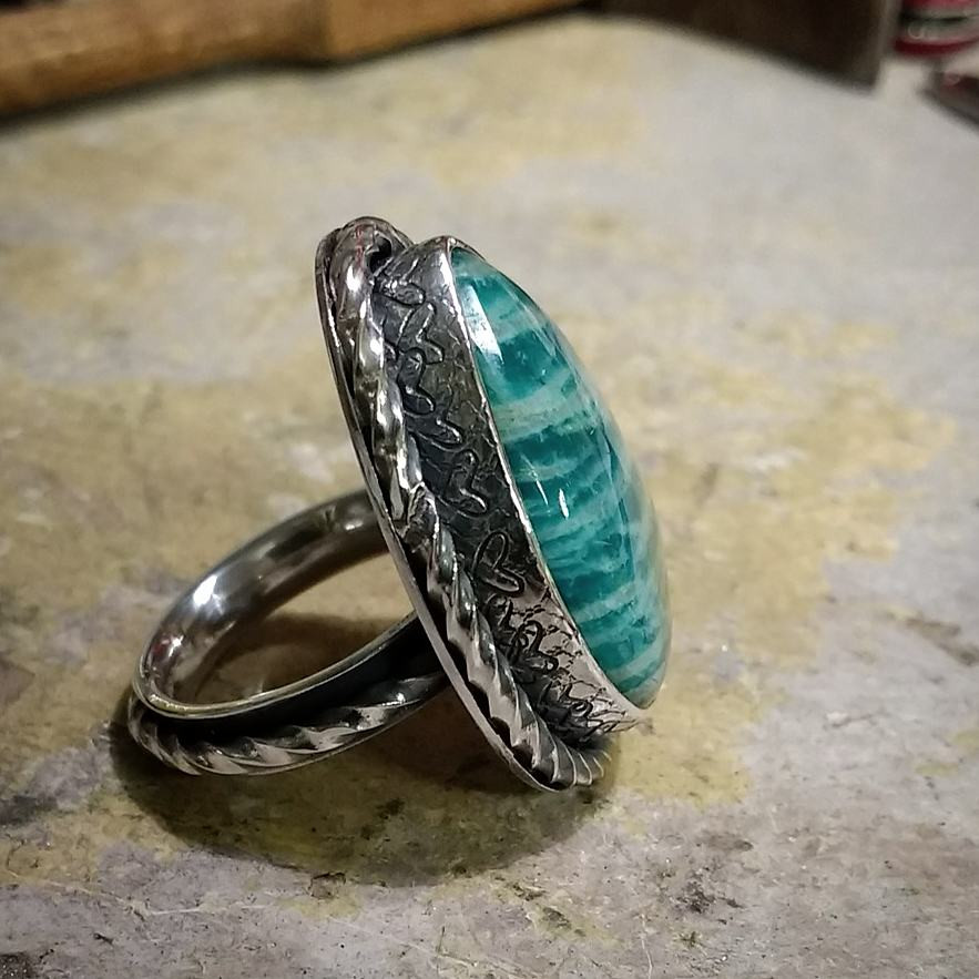 Antique style handmade silver ring with a large Amazonite cabochon set in a heart patterned setting. Uk size O