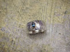 Silve Ring with London Blue Topaz in a 9ct Gold setting