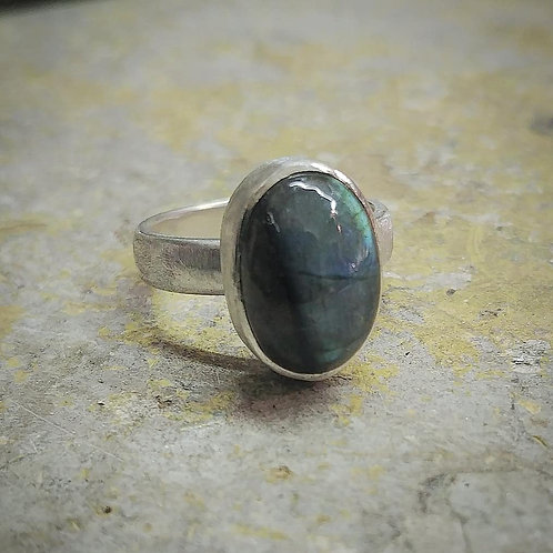 Silver ring set with an oval Labradorite Cabochon
