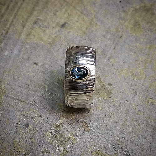 Silver ring with a 9ct set London Blue Topaz