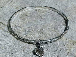 Silver bangle with heart charm- textured finish