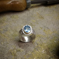 Silver ring with Blue Topaz in a 9ct setting