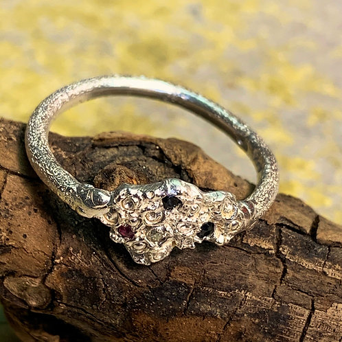 Silver ring set with Ruby and Sapphires and a Diamond