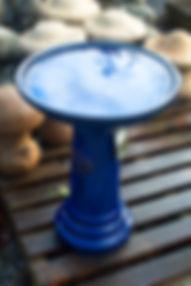 blue terracotta bird bath