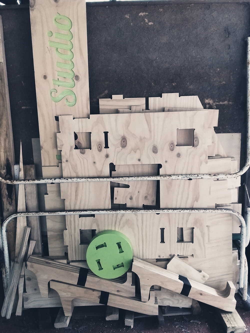 An event display made of plywood machined on a CNC cutter is packed down and in storage