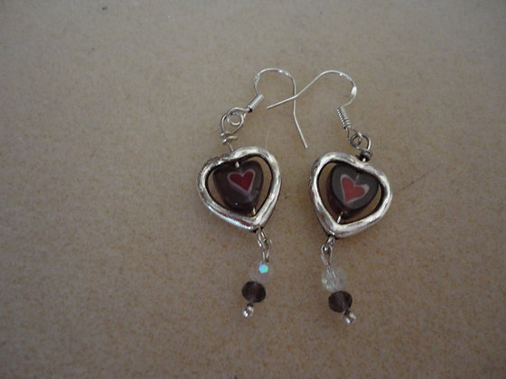 Heart framed earrings