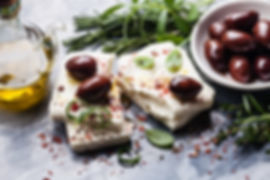 Feta cheese with olives and green herbs