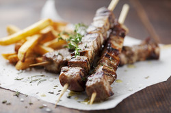 meat skewer with herbs, lime and pita br