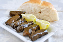 Dolmades with lemon wedges and pita bread.jpg