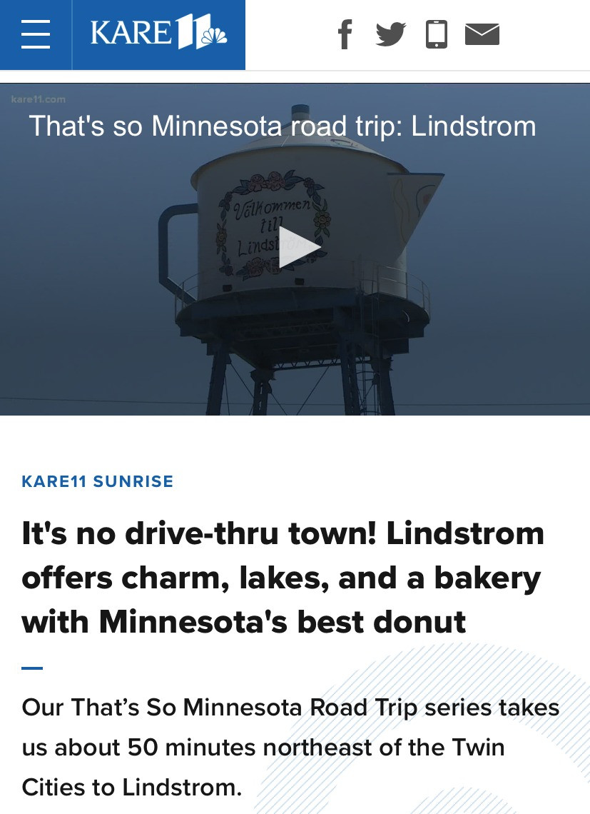 """A screenshot of a news article by local NBC affiliate Kare11 news. Image of a Swedish tea pot water tower with the words """"that's so Minnesota road trip"""". A title says """"It's no drive thru town! Lindstrom offers charm, lakes, and a bakery with Minnesota's best donut."""" Gustaf's Up North Gallery is listed as number 1 thing to do in Lindstrom."""
