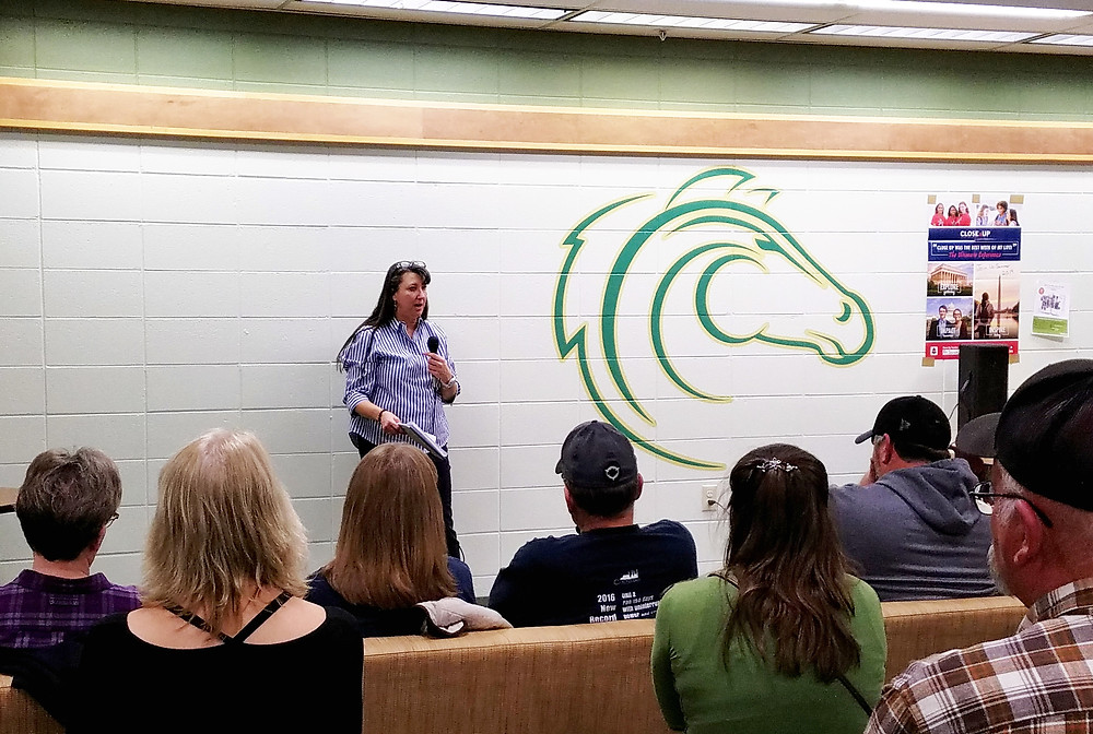 Aimee Reynolds, Bureau Chief for Colstrip Remediation with the Montana DEQ, speaks to an audience of around 70 about Power Plant pond remediation at Colstrip United's informational town meeting, Wednesday, Nov 28th.