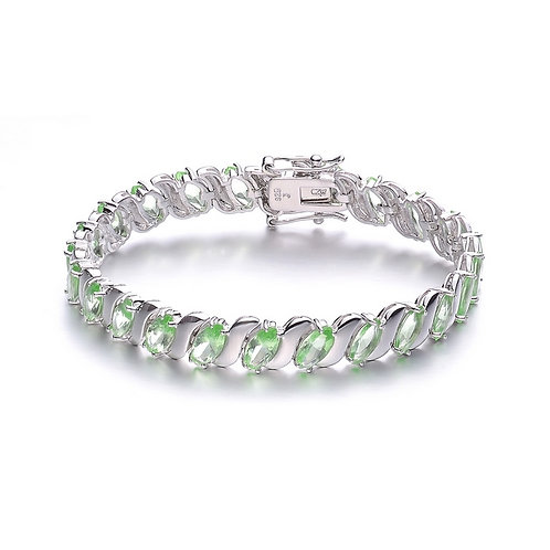SS/ Rhodium Plated Peridot Oval Shape Prong Set Bracelet TCSB-BR1983-PER