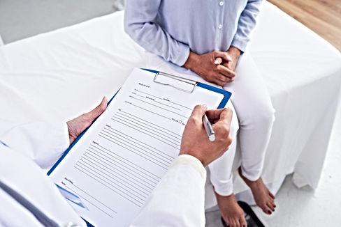 Doctor filling medical card for female p