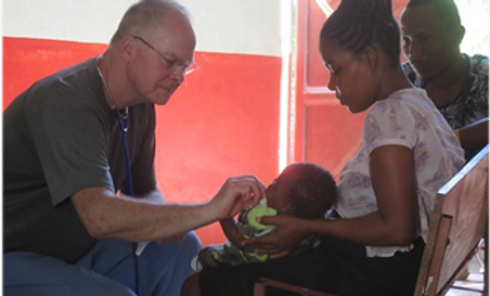 dr neal uitvlught in haiti.png