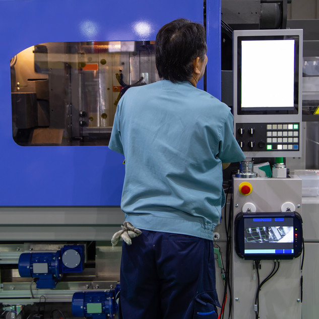 worker operate industrial plastic inject