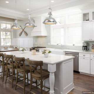 Look no further for coastal kitchen ideas! This kitchen showcases a nautical breakfast nook!