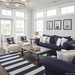 Warm wood floors and plenty of natural light make this coastal cottage living room the perfect place to relax