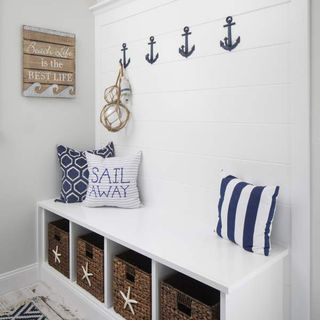The perfect place to kick off those flip flops froma  long day at the beach! Mudroom storage is perfect for organization!
