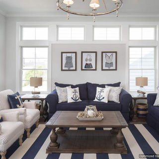 Nautical navy blue/ white interior decor with plenty of natural light.