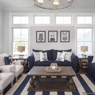 Nautical navy blue/ white interior decor with plenty of natural light.