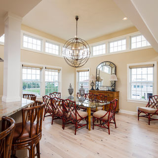 Open-concept dining room with tall ceilings and high transom glass windows!