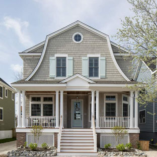 Charming custom coastal cottage home featuring low-maintencance materials and plenty of charm.