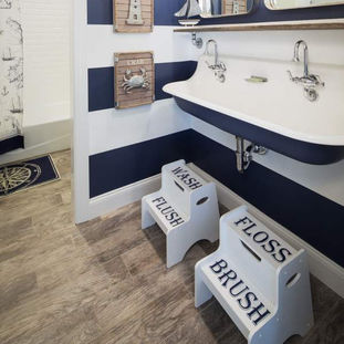 Nautical accents and fixtures make this kids bathroom adorable and fun!