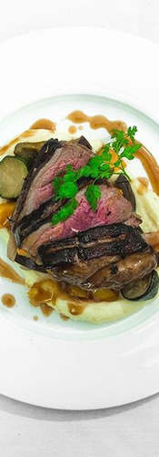 Perfectly pink lamb rump served simply w