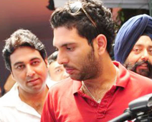 Dr Jatin Chaudhary with Yuvraj Singh