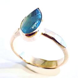 pear shaped aquamarine cabochon on hammered band