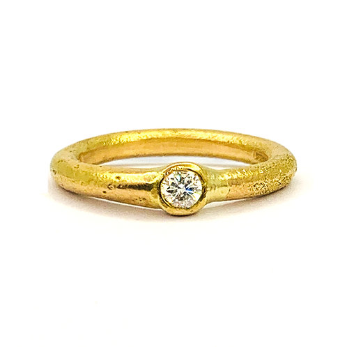 Diamond ring with sand cast recycled 14ct gold band