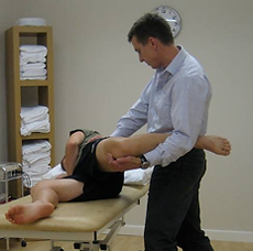 Physiotherapist Graham Theobald treating a physiotherapy patient