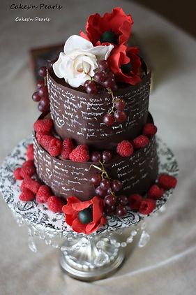Sugar flowers and fresh berries cake