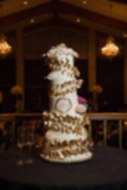 custom wedding cake with gold leaf