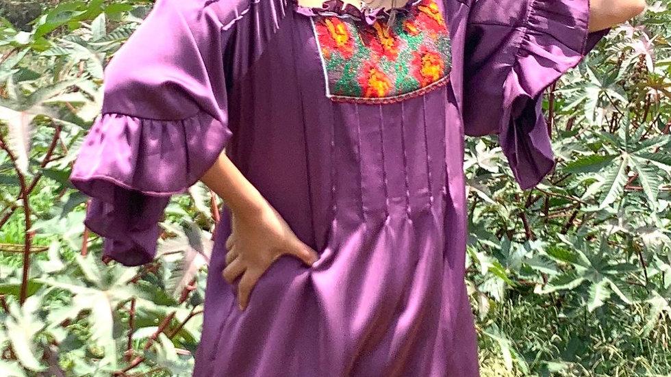 Blusa lila con textil de la región de la costa de Oaxaca