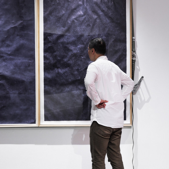 """Viewer contemplating the work: """"Body, Mind, and Spirit"""