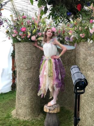 The fairy with glitter makeup in the flower show