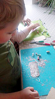 Lucy and Alex using Eco Glitter Fun craft glitter set to create sparkly Christmas crafts!