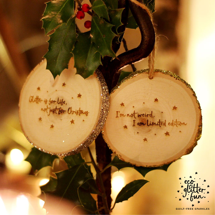 Limited edition wooden Christmas decorations dipped in eco glitter and engraved with glitter inspired quotes.